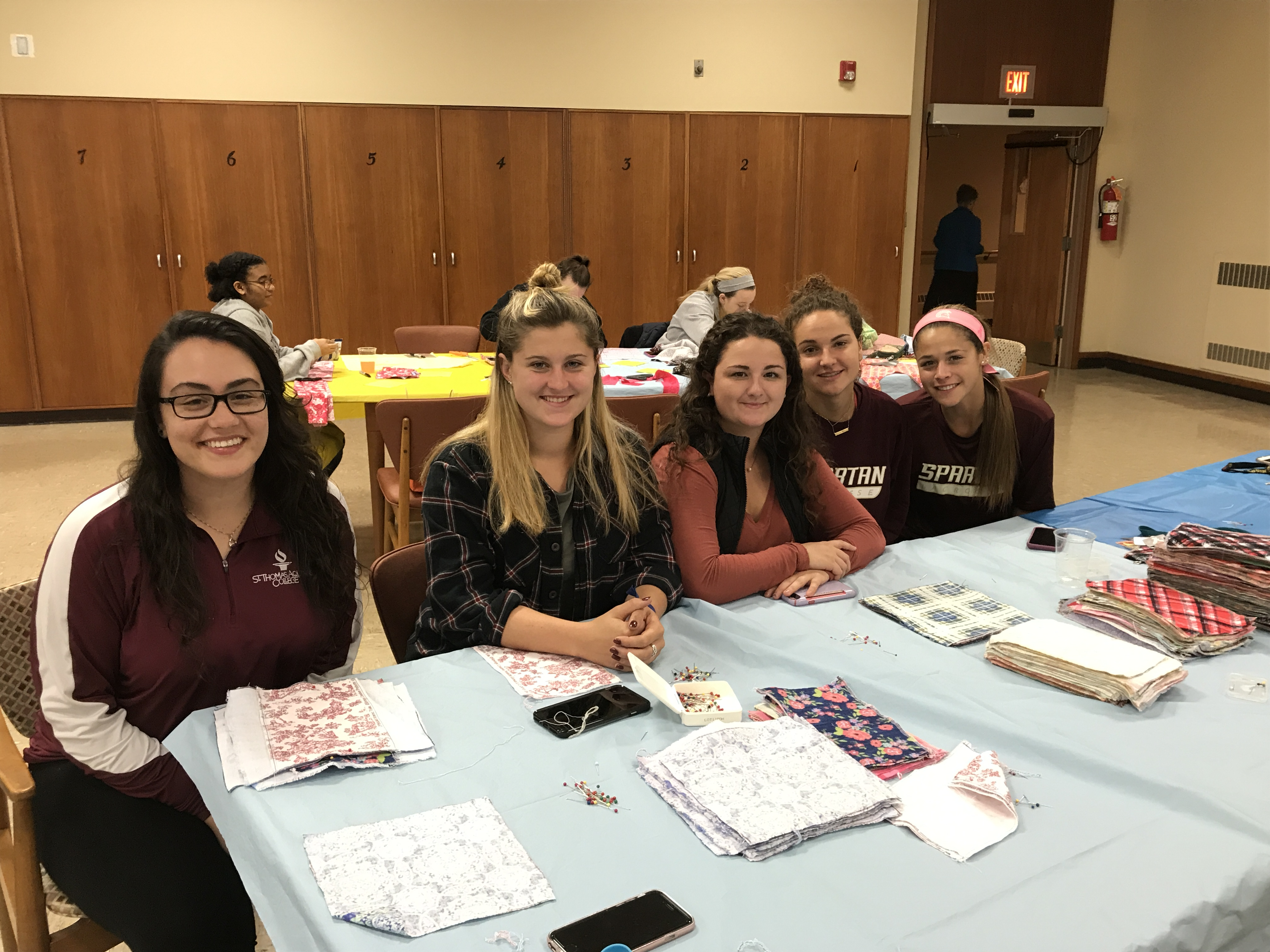 Student volunteers working at Days for Girls event