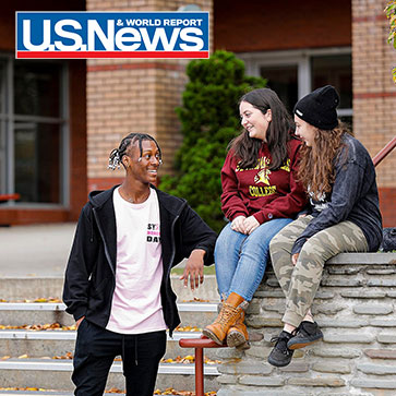 3 students in front of Poggi terrace outside 2 seated 1 standing chatting and smiling. US News red white and blue logo top left