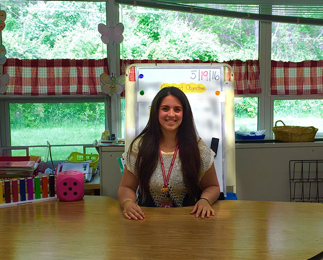 Christina Riccobono sitting at elementary school classroom