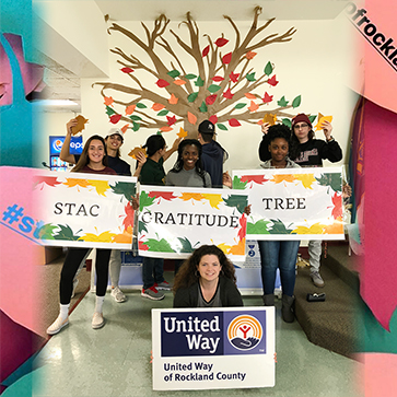 """Image of STAC students in front of the United Way of Rockland's """"Gratitude Tree"""""""