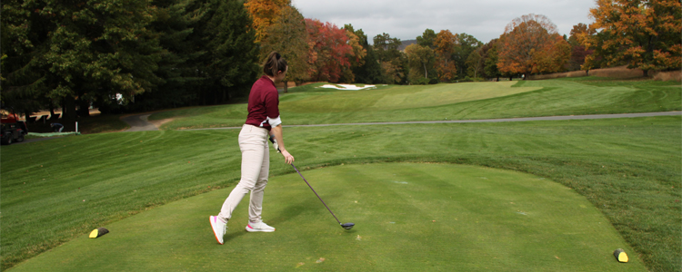 Kaitlyn H. after swinging golf club on the green