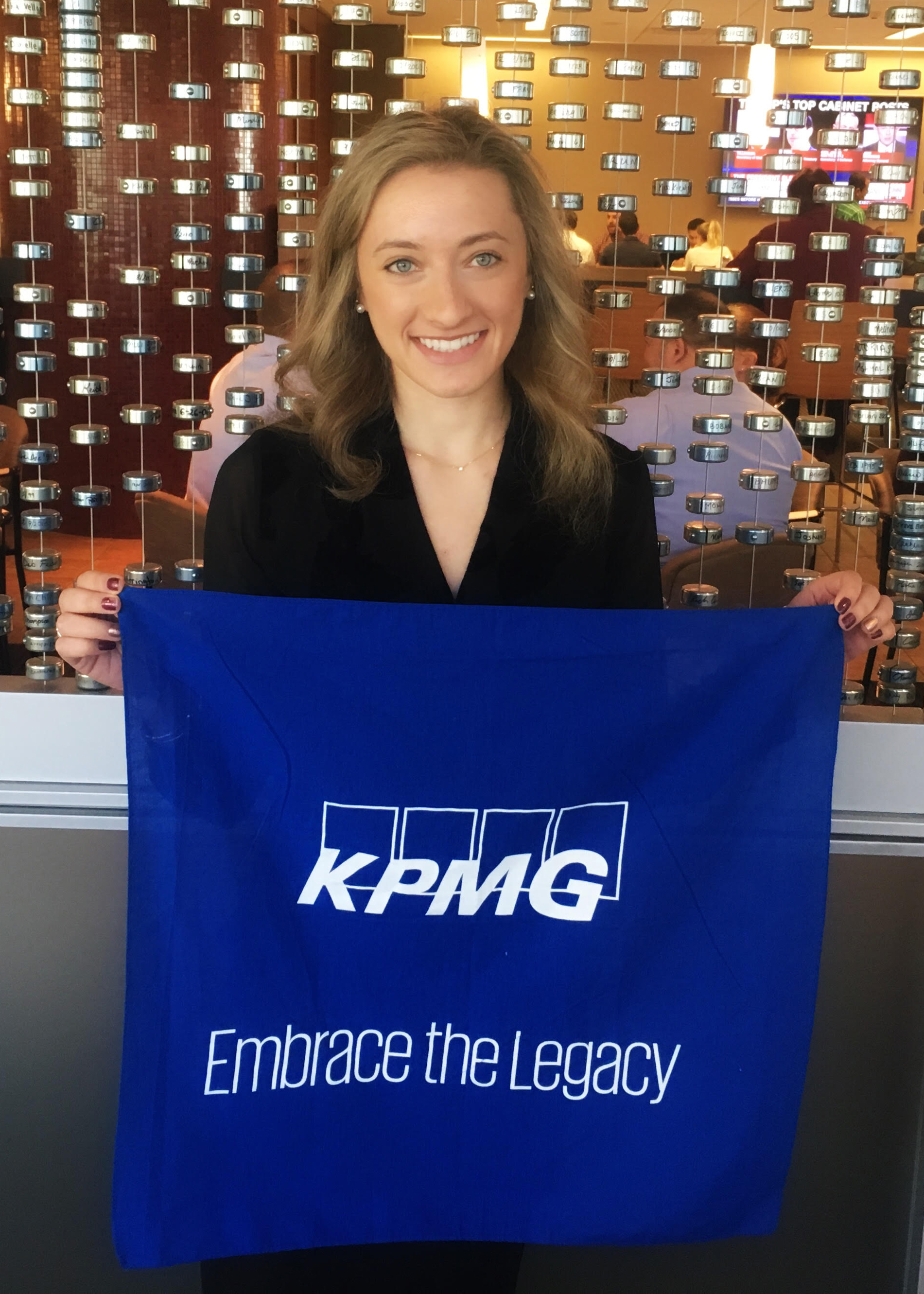 Jeanine Grillo holding a KPMG flag