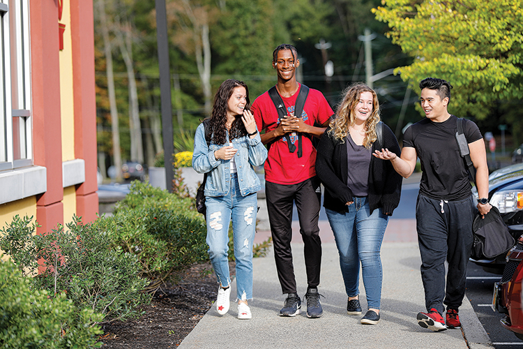 diverse group of students walking together on campus