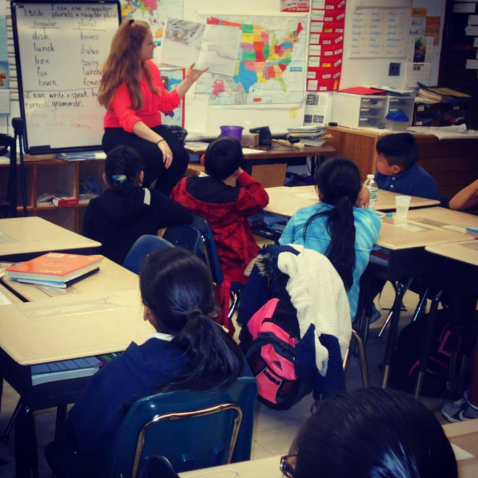 Shannin Davin teaching at elementary school classroom