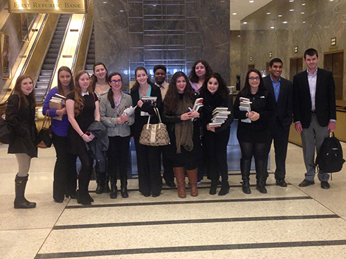 STAC students pose with free books from Simon & Schuster.