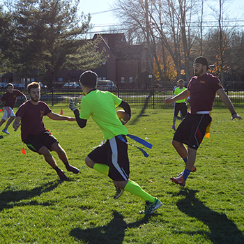 Students playing flag football on STAC campus