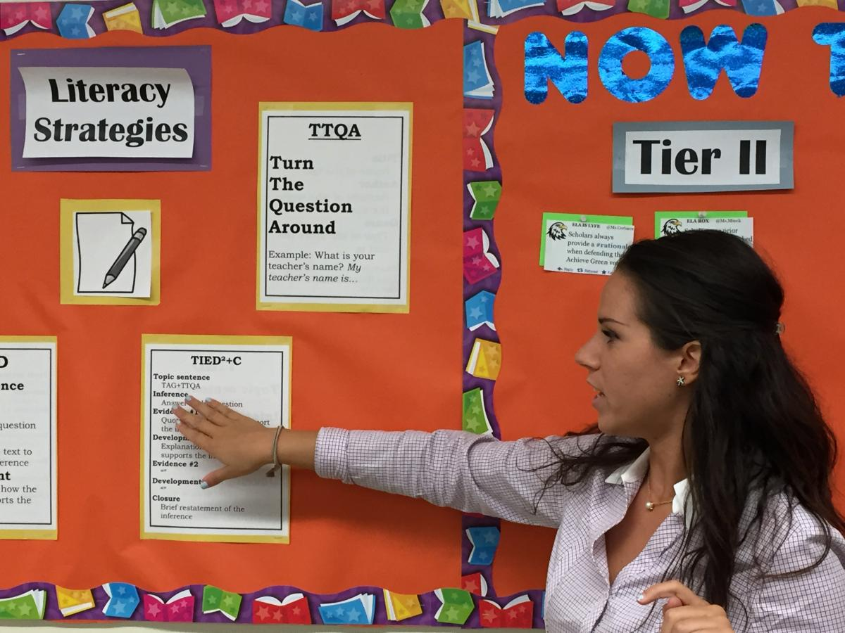 Student showing a bulletin board display
