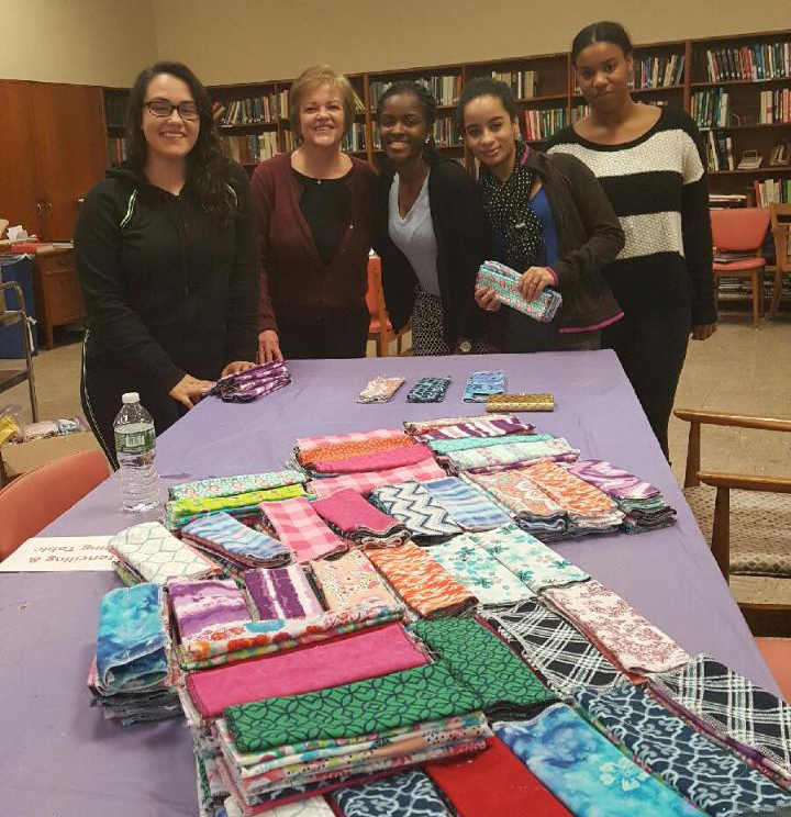 STAC HEOP students volunteer with Eileen Mastrovito, Director of Health Services, at the Days for Girls Project.