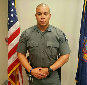 Jordan Aquille in a New York State Trooper Uniform