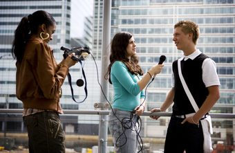 Journalist interviewing a young male