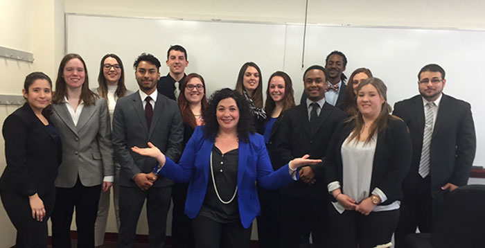 Professor Winship with students dressing professionally