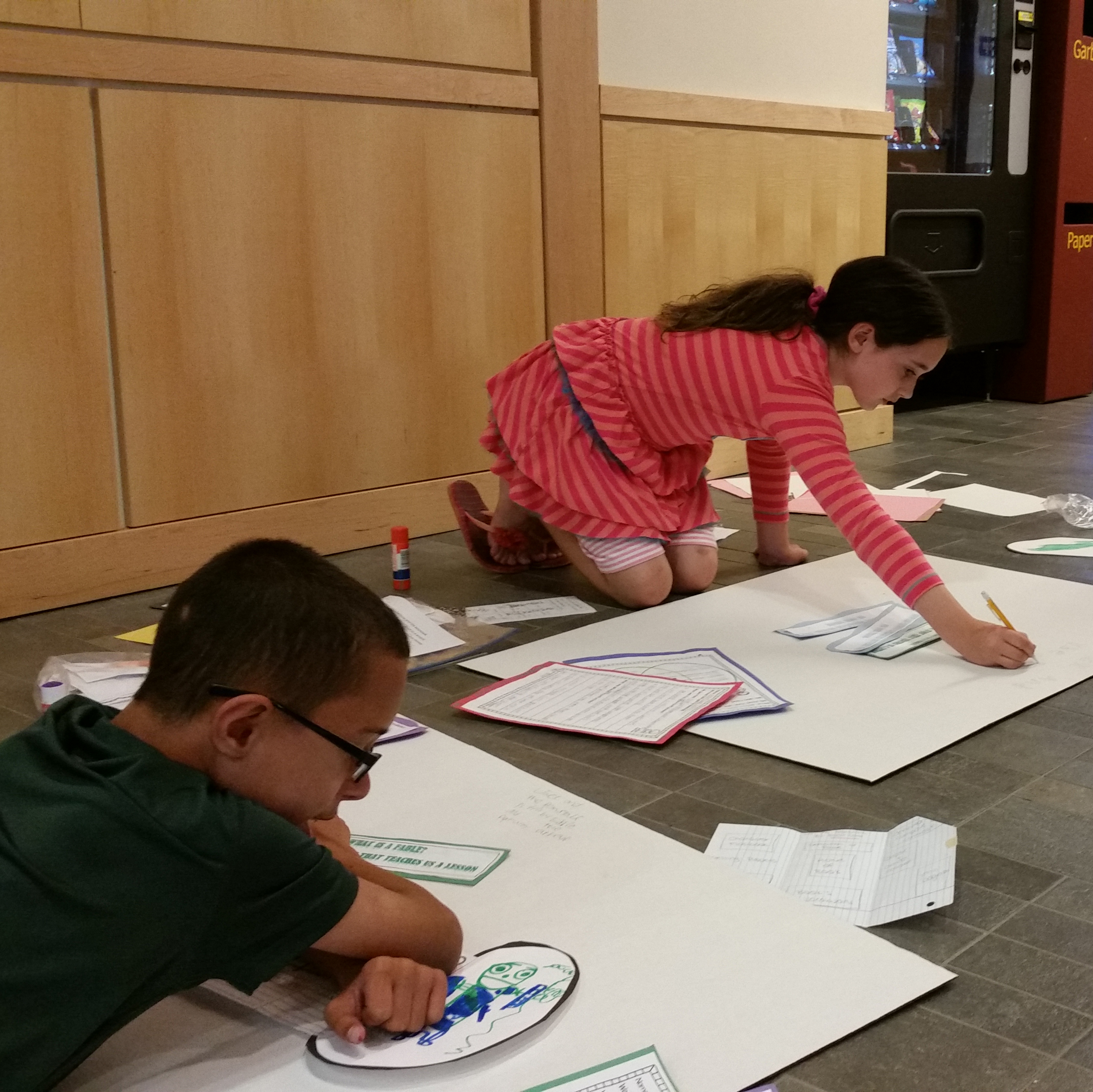 boy and girl students working on summer camp project