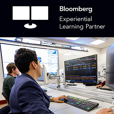 Bloomberg Experiential Learning Partner black and white text at top; student in suit jacket in Lab working on computers