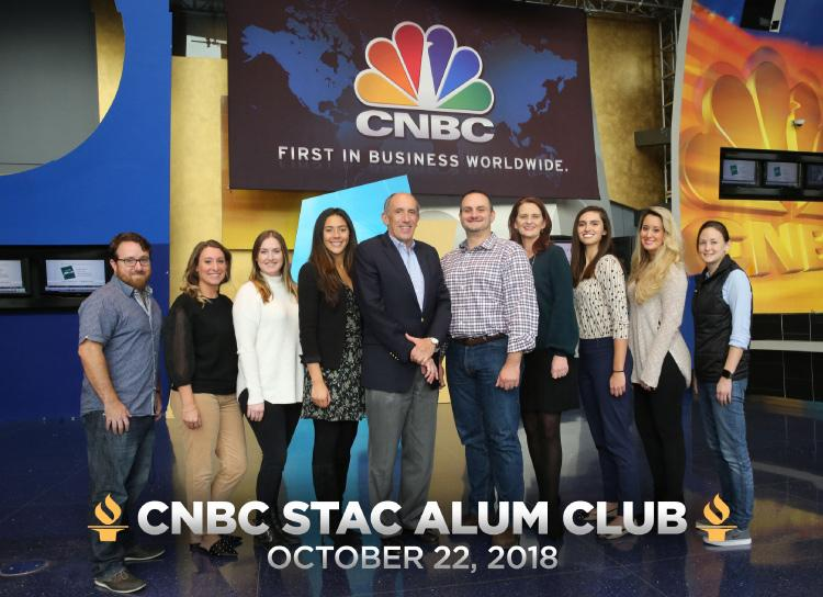 STAC Alumni CNBC Team posing in CNBC Studio with Dr. John Durney from STAC. Photo Caption - CNBC STAC Alum Club, October 22, 2018
