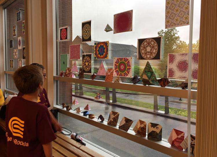 Middle school students looking up to Mandalas