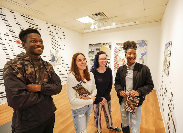 STACstudents looking at art in Azarian McCullough Gallery