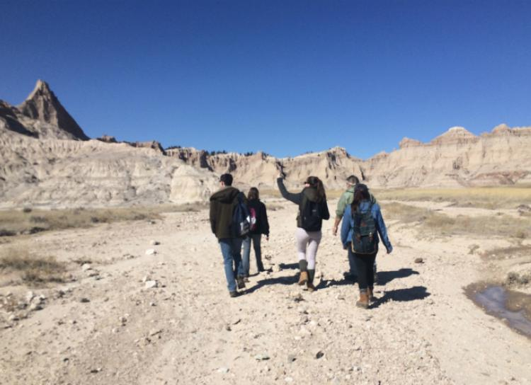 group of 4 people exploring the dessert