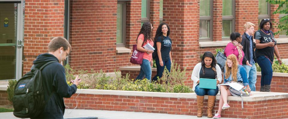 Students hanging out in front of Borelli Hall on Campus