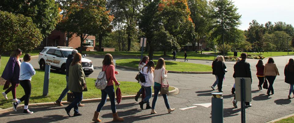 Students and families walking outdoors near Borelli and RSAC buildings on campus tour