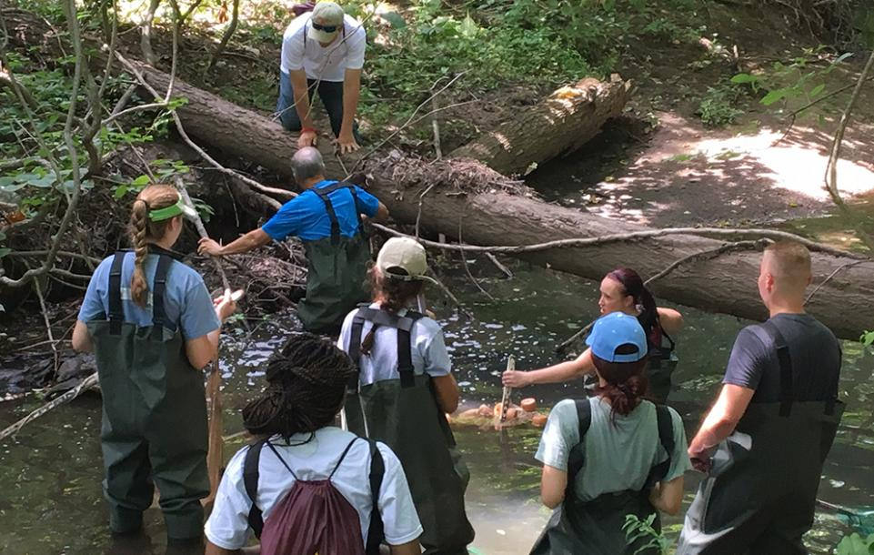 Dr. Rosko and Professor Holt with Suez students at the Sparkill Creek