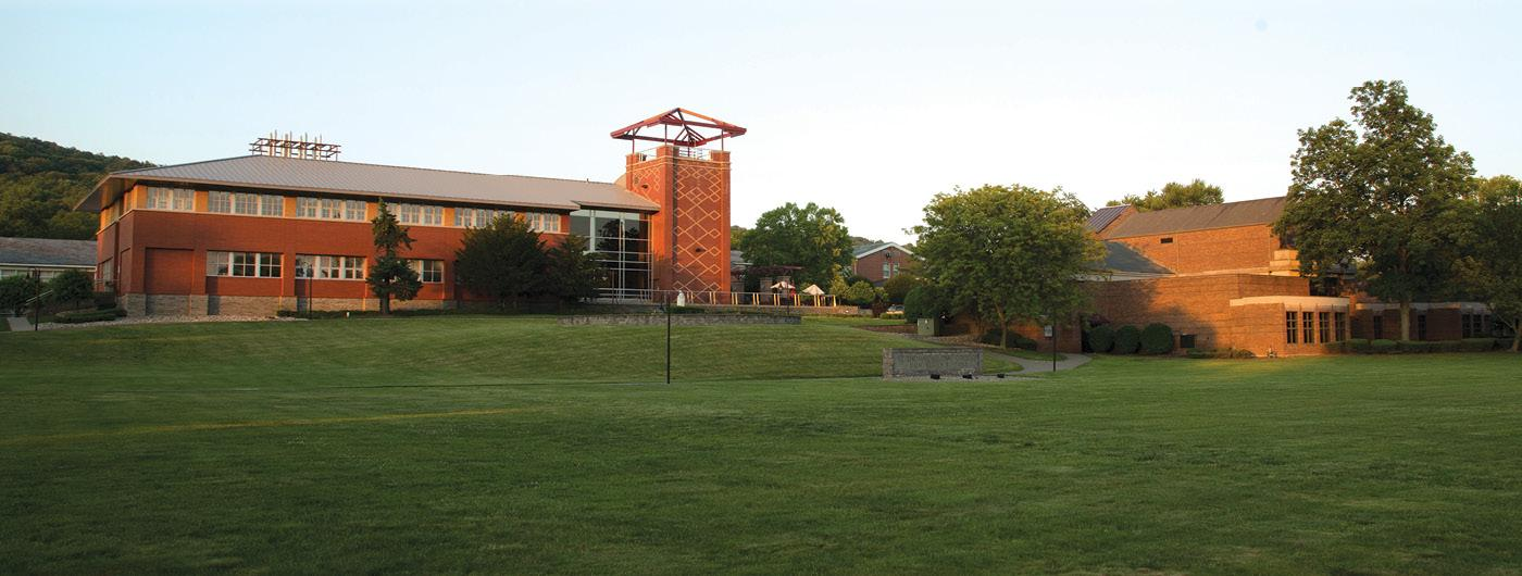 2022 Annual Hall of Fame with STAC torch logo and campus shot of Costello Hall in the background