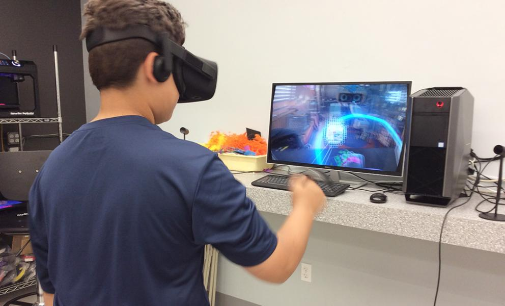 Boy interacting with a virtual reality game
