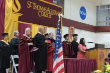 community members and honorees on stage at previous honors convocation