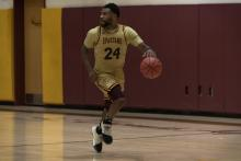 spartan basketball player Shaquille McFarlan in action at a game.