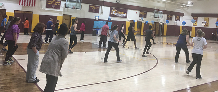 community members participate in zumba for autism